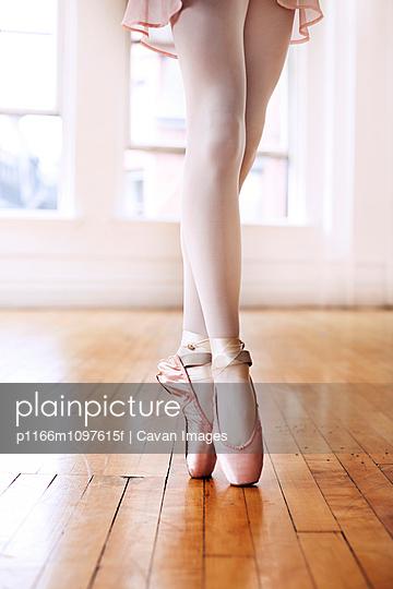 Young ballet dancer standing on tiptoes