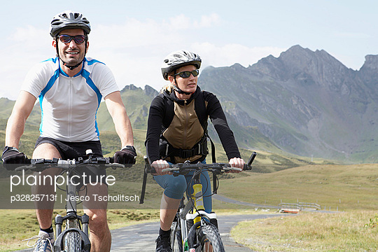 Couple cycling in the mountains