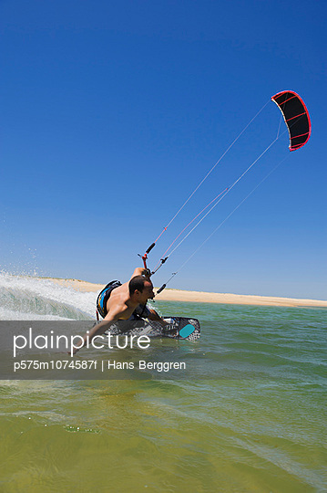 Man kite surfing on sea
