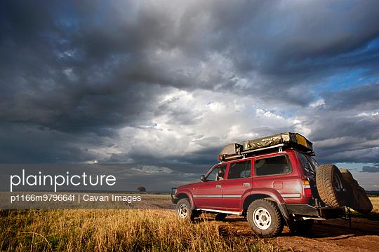 SUV on Safari in Masai Mara, Kenya