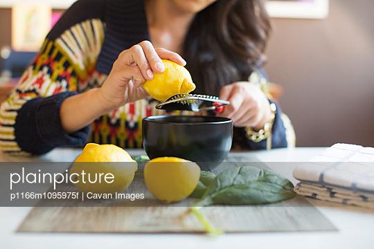 Woman testing lemon