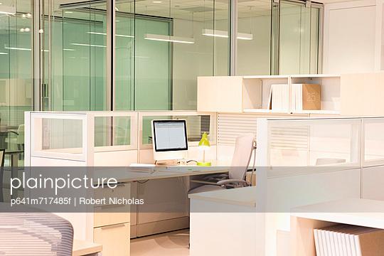 Empty, modern desk in office cubicle