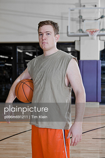 Portrait Of Basketball Player Posing On A Court