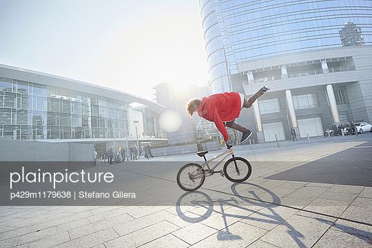 BMX Biker doing stunt in urban area