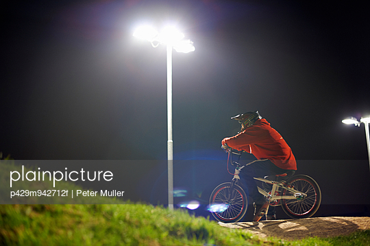 BMX-cyclist riding at night time