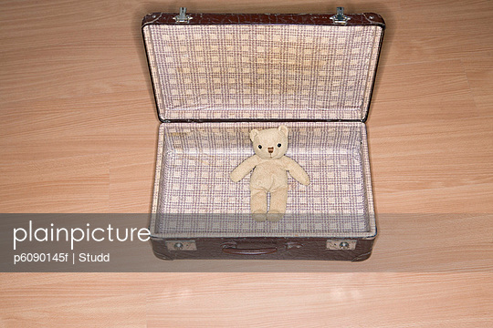 Open suitcase with Teddy Bear
