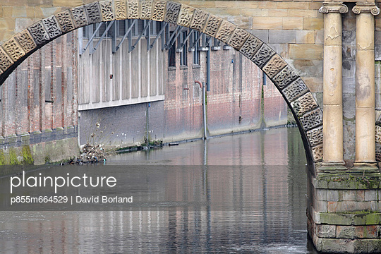 Neo-classical bridge over River Irwell in City centre, with new apartment blocks in background, Manchester, UK.