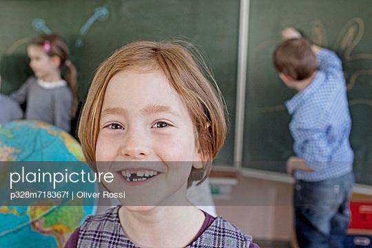 Happy young school girl (6-7)