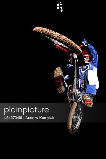 A man launches his BMX bike