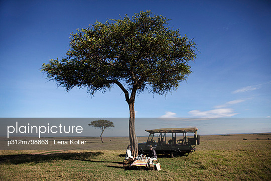 People resting near safari truck
