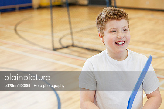 Male student with floor hockey stick.