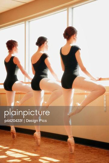 Three women practicing dance