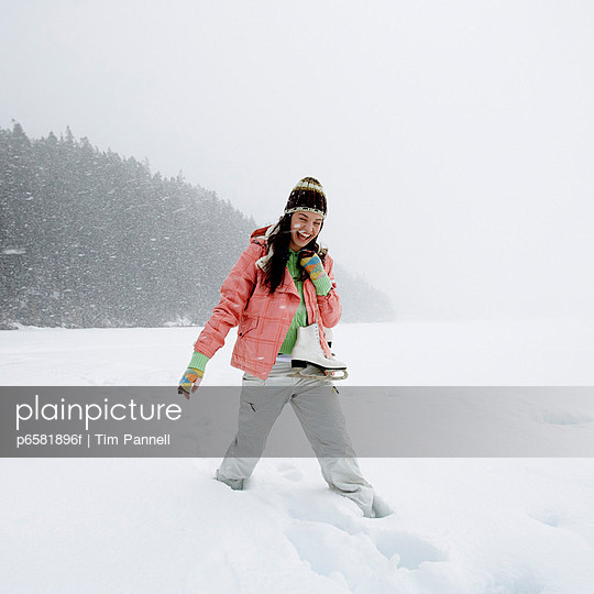 Woman Enjoying Snow