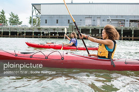 Woman kayaking in harbor, New York City, New York, USA