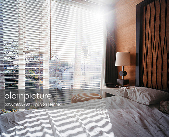 Hotel Bedroom With Backlight Through The Window.