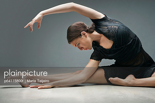 Dancer stretching on floor