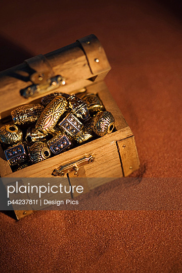 Golden beads in a box