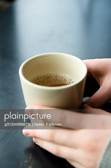 Hands holding mug with tea
