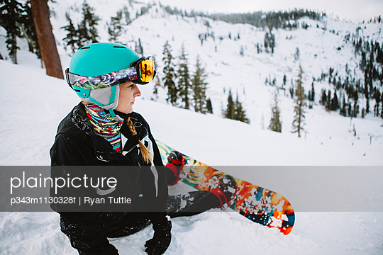 A woman snowboarding in Lake Tahoe