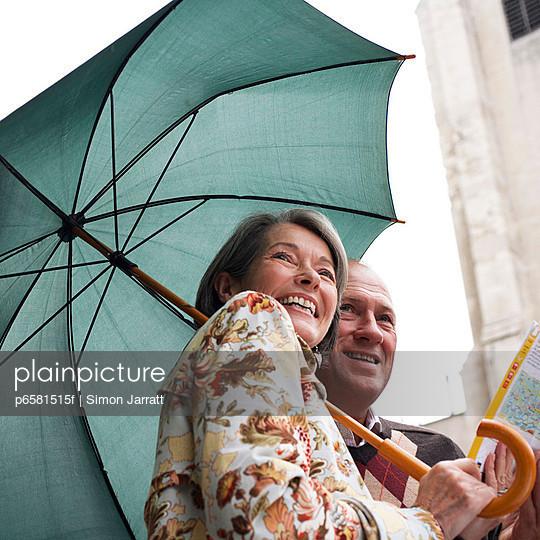 Couple Sightseeing on Rainy Day