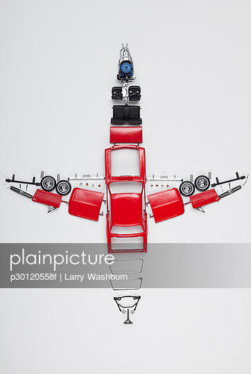 Parts of a model car arranged in the form of an airplane