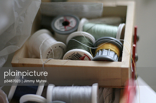 Rolls of thread in a box