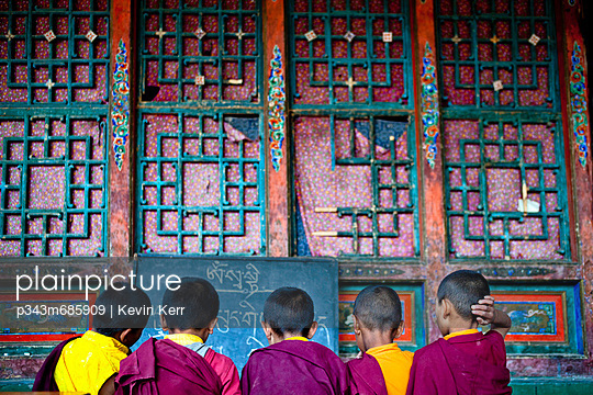 Novice monks studying on the grounds at Hemis Monastery in India.