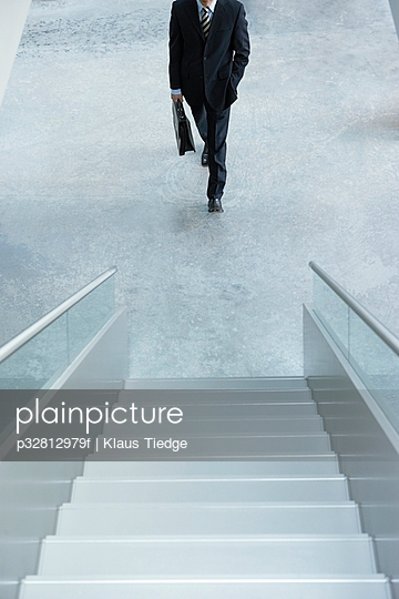Businessman approaching staircase