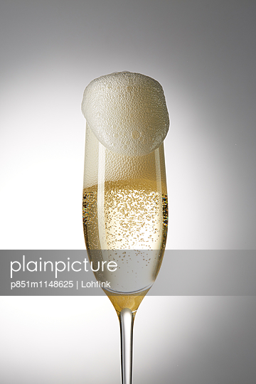 Glass with sparkling champagne