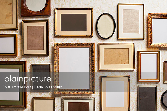 Various empty picture frames; close-up