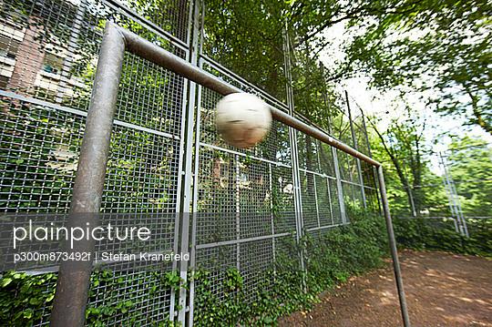 Soccer ball mid-air at goal