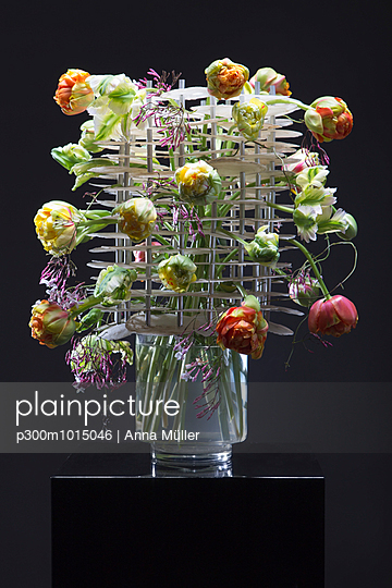 Floral arrangement of Gardenia jasminoides, capiz and different tulips