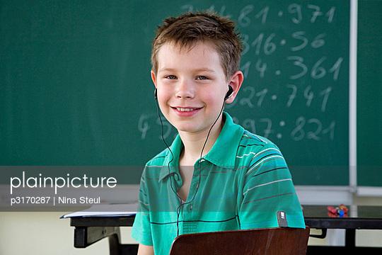 Schoolboy with earphones
