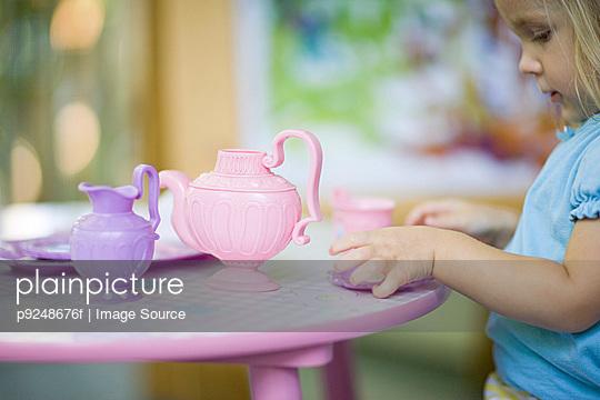 Girl having tea party