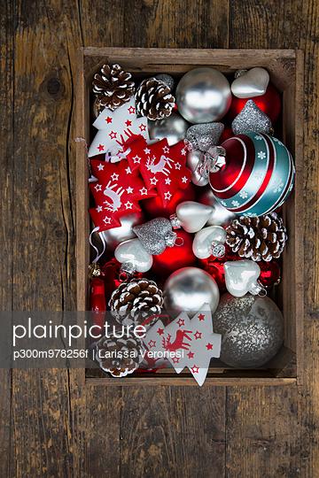 Box of Christmas decoration on dark wood