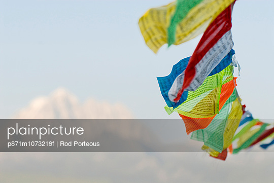Prayer flags blowing in wind, Snow mountain, Tagong, Sichuan, China, Asia