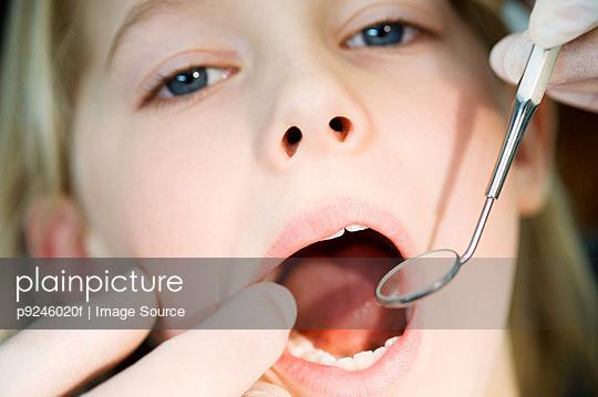 Girl having dental check up