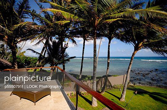 Deck Chair on Balcony Patio by Ocean