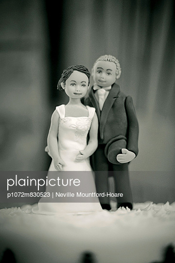 Iced Bride and Groom figures on top of wedding cake