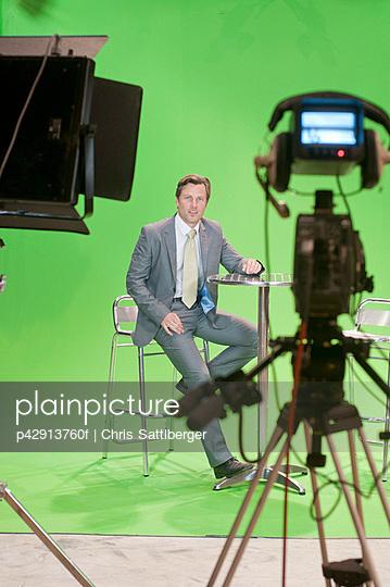 Presenter in TV studio with green screen