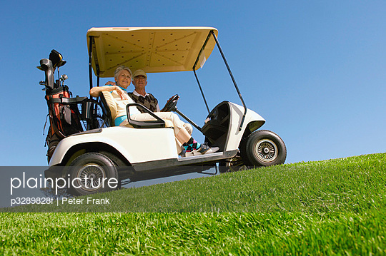 Couple sitting in golf cart