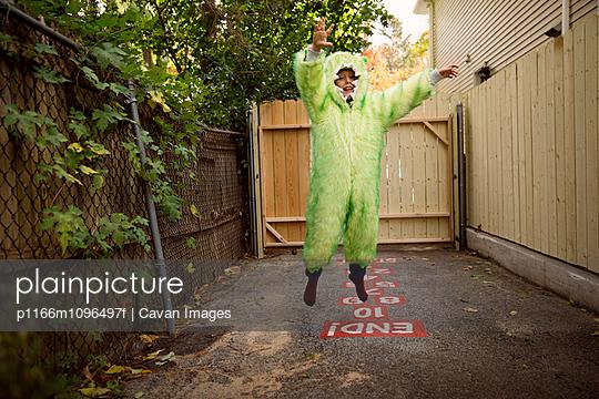 Boy (6-7) wearing Halloween costume