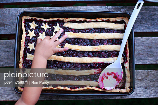 Fourth of July Blueberry Pie With Child\'s Hand