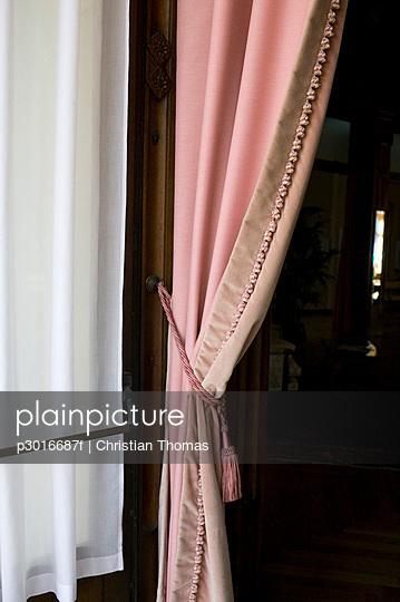 Pink curtain in a doorway