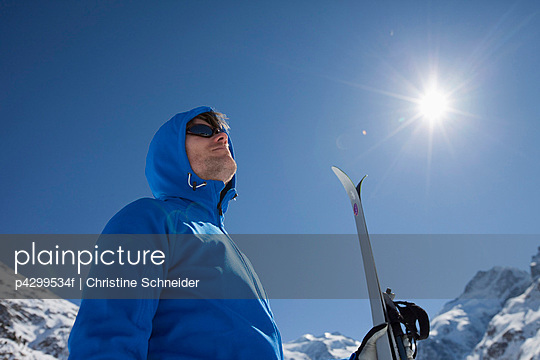 Man with cross-country ski in winter