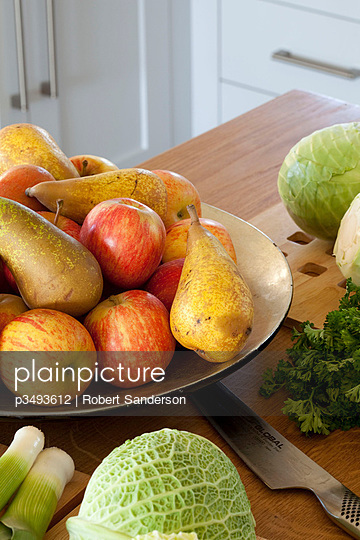 Bowl of fruit on kitchen workbench