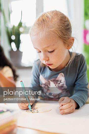 Girl using felt tip pen in drawing class