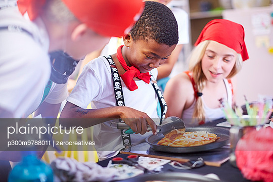 Children dressed up as pirates eating pizza on a party