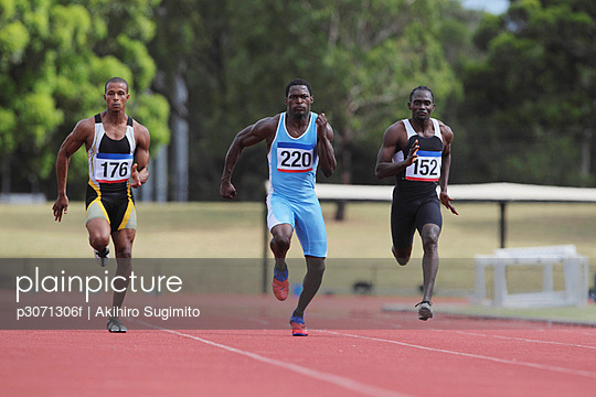 Runners On Race-Track