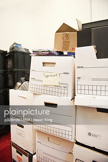 Stack of messily packed boxes